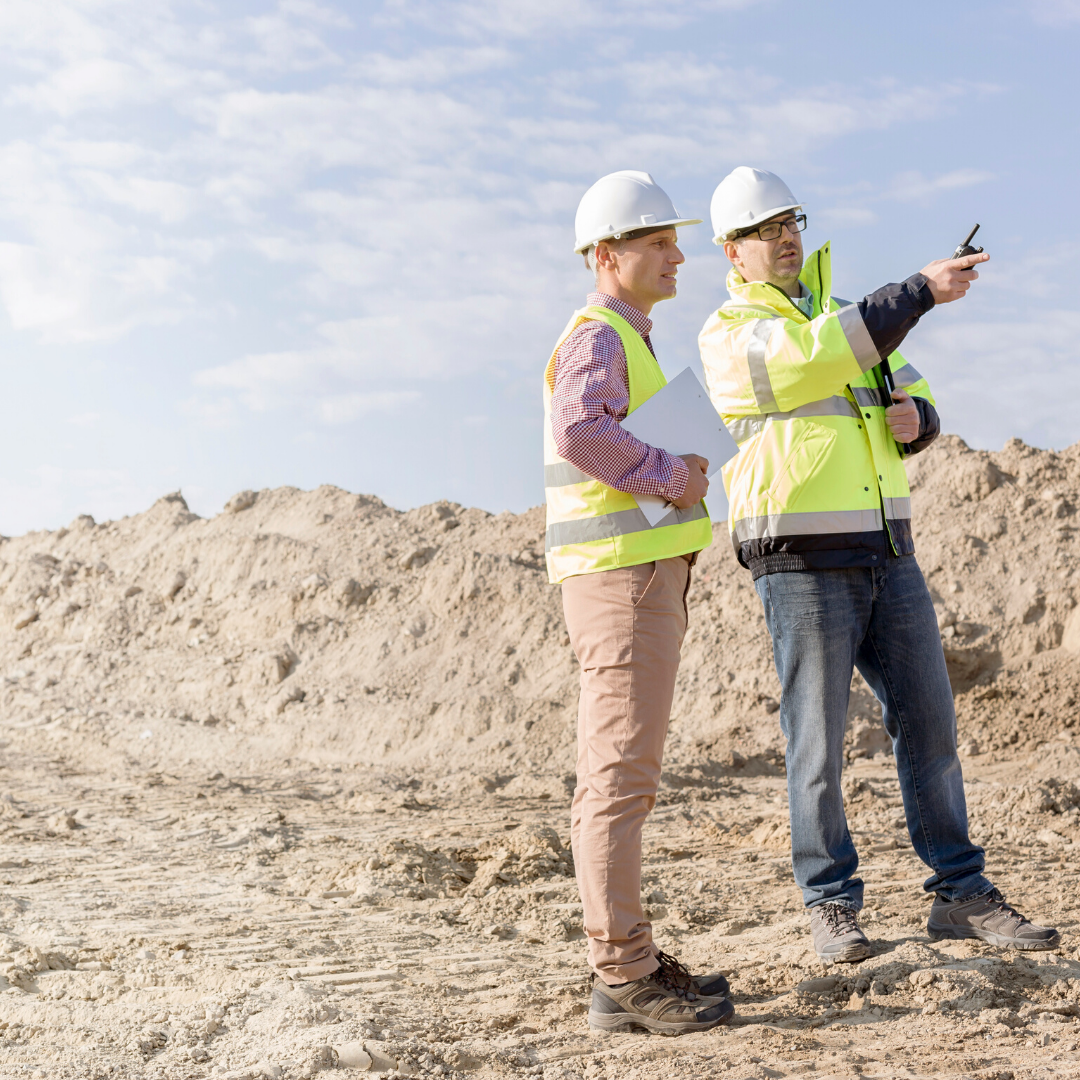commercial plumbing and drain experts discuss the site of a new installation